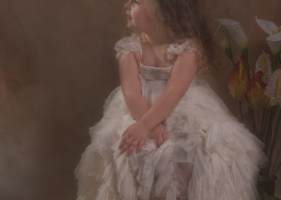 Image by Michaela-De-Freitas - Old style portrait of a child with a roman twist.